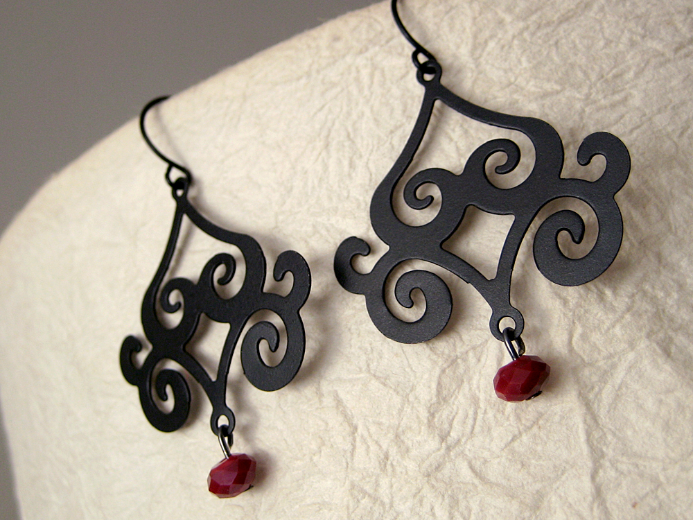 The dad project feature friday 23 chandelier earrings by these darling chandelier earrings from urbanite jewelry are simply stunning striking matte black is set off by gorgeous red crystals making these a aloadofball Image collections